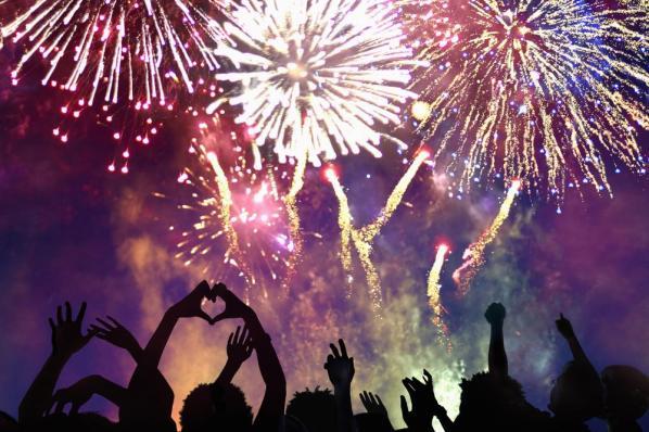 Crowd of people enjoying firework display